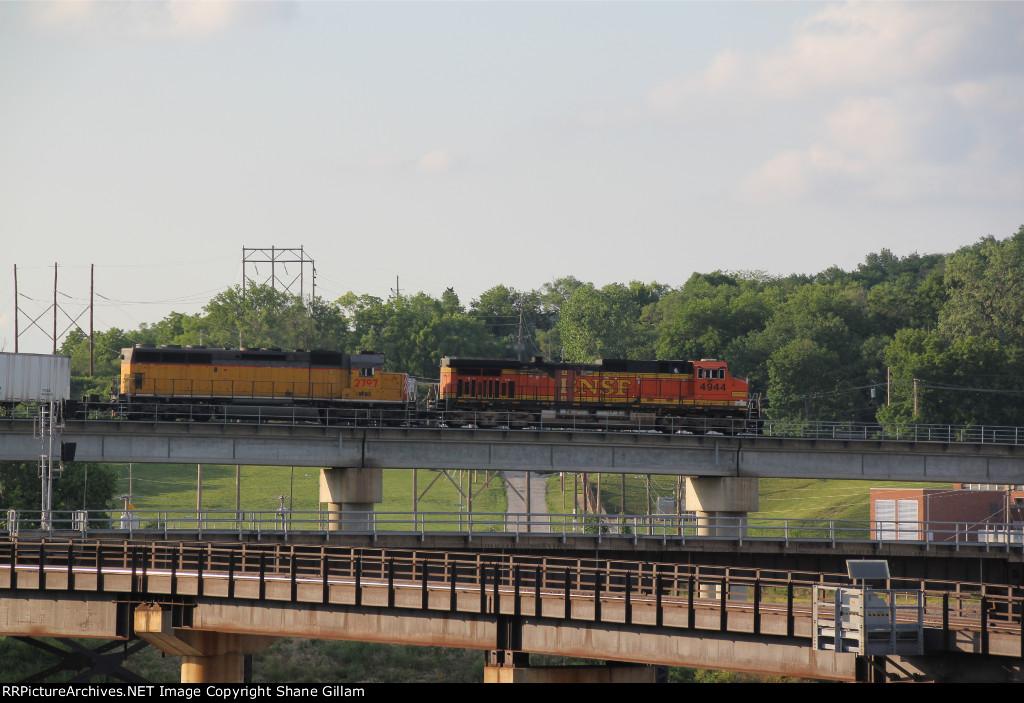 BNSF 4944 Leads a OFOX SD40-2 on a triple crown train.