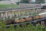 UP 3810 Heads up a WB rack train into Kc Mo..