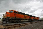 BNSF 7863 Rolls a Westbound Sand train out of the storm clouds..