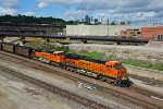 BNSF 6257 Heads a SB coal load while Kc Mo looms in the back ground.