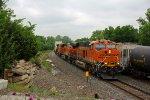 BNSF 6591 Heads up a WB Q past a EB freight train.