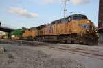UP 5914 Strolls through downtown KC Mo with a stack train.