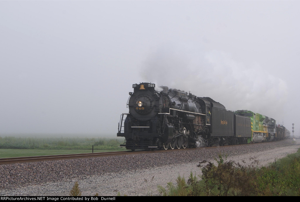 NKP 765 heads for St. Louis at County Road 900N with Heritage units in tow