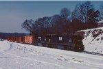 A northbound rail train passes through Clemson in the snow.