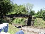 Old one lane highway bridge, now a railfan spot