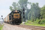 Northbound local from town heads towards Fostoria with a slug set on a sultry summer day