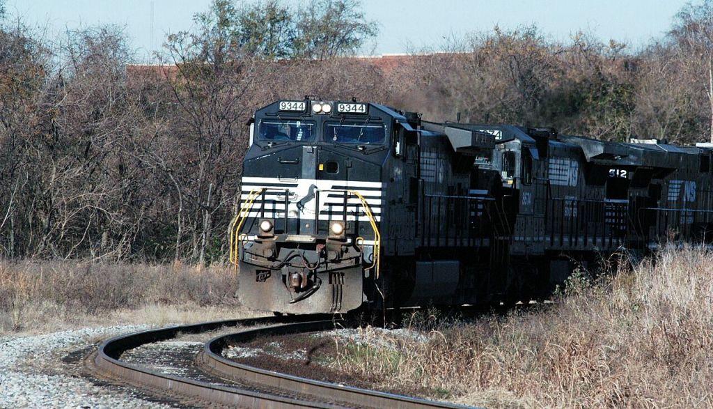 77E EMPTY COAL TRAIN COMES OFF THE W LINE