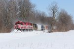 GDLK303 kicks up some of the fresh snow as it rolls south