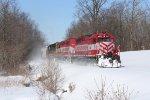 Rolling alongside frozen Buck Creek, GDLK303 makes its way south toward Kalamazoo
