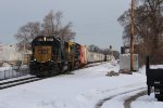 CSX 8574 pounds the switch at Seymour as it leads D907-14 east
