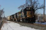 CSX 8574 leads 3 more units as Q334 rolls east onto the single track at Seymour