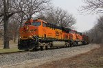 BNSF 7353 & 8980 swing westward around the curve at Seymour with Detroit Edison coal empties