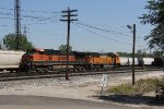 After being brought to the west end by a yard crew, BNSF 1052 & 8817 wait for an evening departure west
