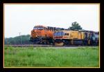 BNSF 7352 passing LORAM RG-308