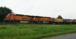 BNSF 7352, 8064 passing LORAM RG-308
