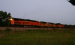 Renzenberger dropped off a fresh crew, and BNSF 7806 (nb) Herzog ballast empties pulls out of Flynn