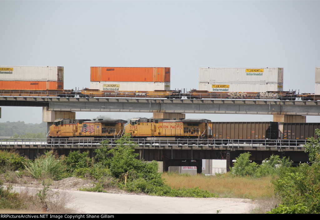 UP 5891 Leads a WB coal train while a WB BNSF race's over top.