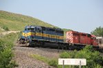 ICE 6448 heads up a empty grain train on the Transcon.