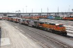 BNSF 906 Leads a power move of unit's into Argentine yard.