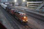 BNSF 7039 Heads a stack train west past union station..