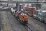 BNSF 7166 Rolls a stack past a EB stack at Union station.