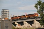 BNSF 6982 Rolls a stack over the flyover into the setting sun.