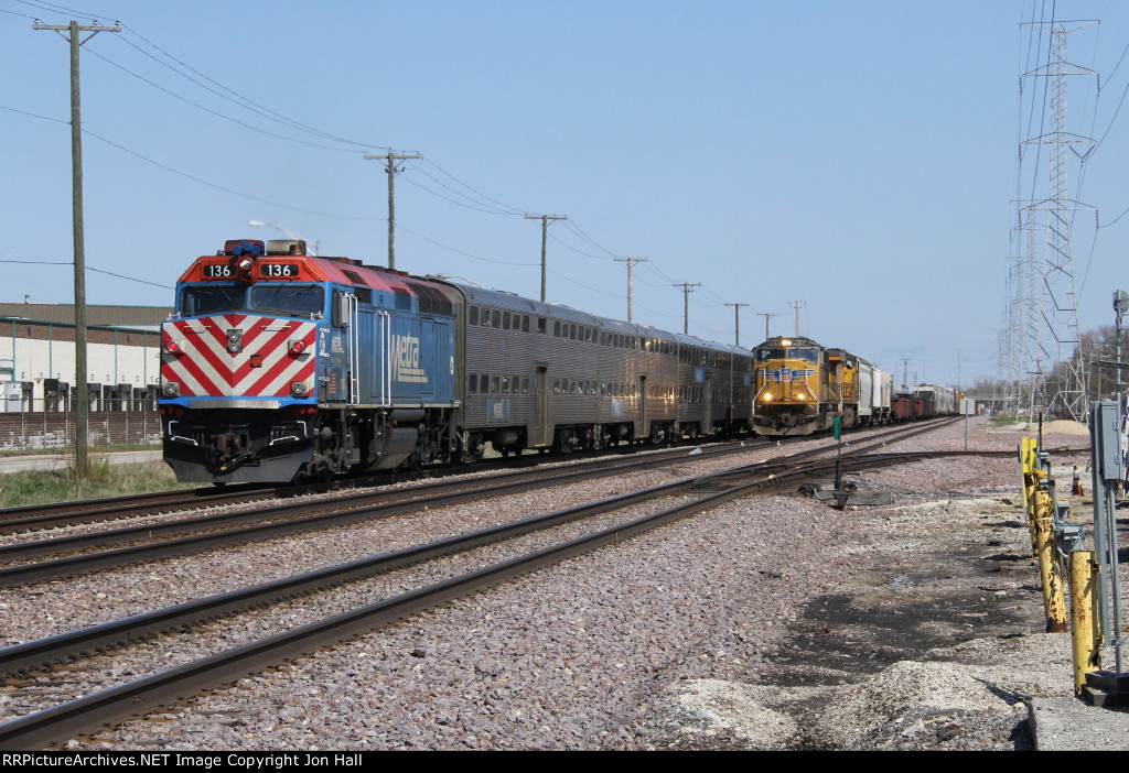 METX 136 shoves away east as it meets a westbound UP freight