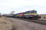 A DME GP38 leads a pair of SD40's south with ethanol train 644