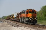 BNSF 2129 & 2002 bring a train of track equipment east