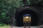Q157 blasts out of the tunnel