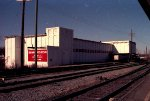 Brown Roger Dixon appliance warehouse across tracks from Seaboard Station