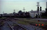 SBD 5868 leads two other B36-7's and a TOFC train past the signals at the north end of the yard