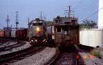 SBD 8334 leads a southbound train past the caboose on a northbound piggyback train