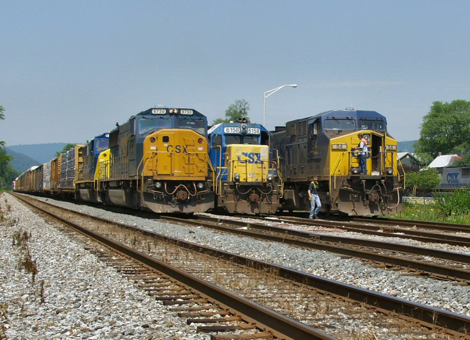 Eastbound Manifest Awaits Orders While a Loaded Eastbound Coal Drag Stops to Add an Extra GP