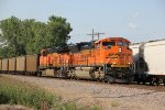 BNSF 9099 Leads a coal load past a NB freight in the siding.