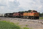 BNSF 5000 Heads up a CP/NS combo on the Hannibal Sub.