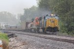 CSX 4570 Heads a Epic lash Up Nb in the pouring rain..