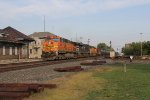 BNSF 5010 leads the way west across the diamond with K081
