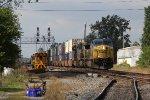The hottest train on the railroad, Q010 races east through West Deshler
