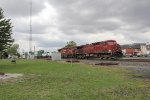 A pair of grungy CP AC4400's make good time east through Deshler with Q166