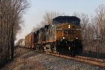 Ducking in and out of the late day shadows, CSX 69 leads Q559 southward toward Dayton