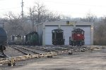 3887 & 2342 sit outside the shop as dead IORY power and the Cincinnati Railway's NKP 901 sit out back