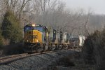 CSX 4802 leads Q365 south through the morning shadows