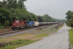 CP 8715 & CEFX 1018 climb eastward with loaded oil train 606