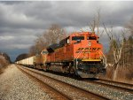 BNSF 9204 at the point with empty hoppers