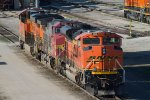 BNSF9196, SF738 and others waiting by the diesel depot