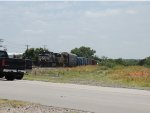 NS 9300 along with UP 4486 are approaching the grade crossing with a mixed freight train.