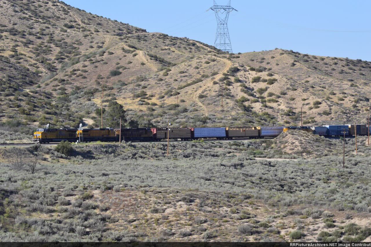 A manifest passes a train in the hole at summit