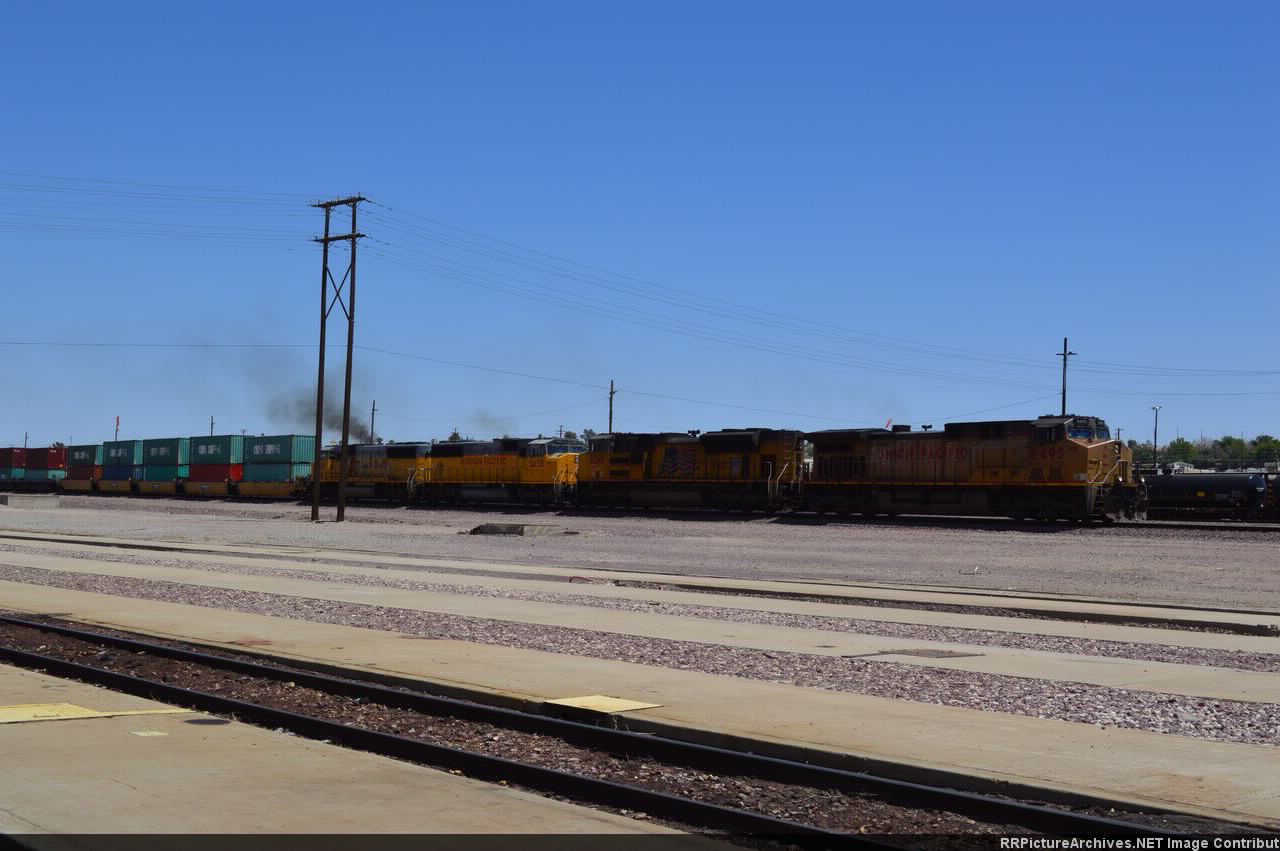 A UP stacker moves west through Barstow.