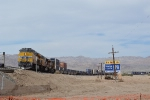 UP 8136 and its stack train curve by an interesting billboard